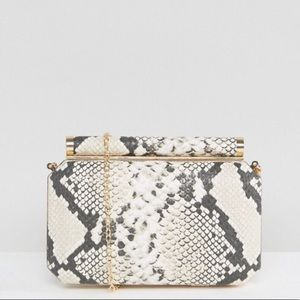 Never used clutch. Removable gold chain comes with